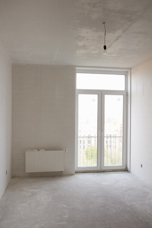 building repair - empty room with white wallpaper and big window photo