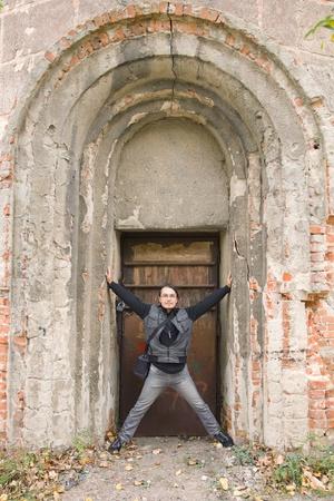 Man standing in old arched abandoned door in Korosten, Ukraine photo