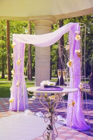 Luxury wedding gazebo with flower arrangements in summer park photo