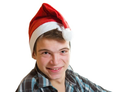 Portrait of a teenager in Santa Claus hat, isolated on white background photo