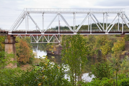 The railway bridge and Uzh River in Korosten, Ukraine photo