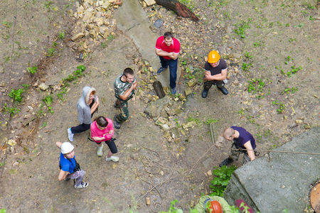 High view of group of people practice at a climbing training photo