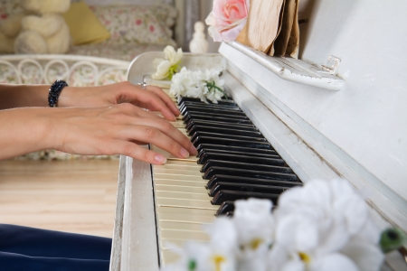 Close up hands of young woman playing piano
