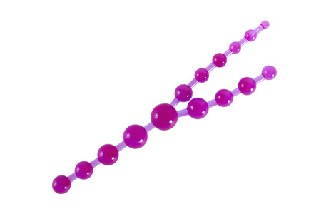 Purple beads - sex toy for triple penetration made of rubber or latex isolated on white photo