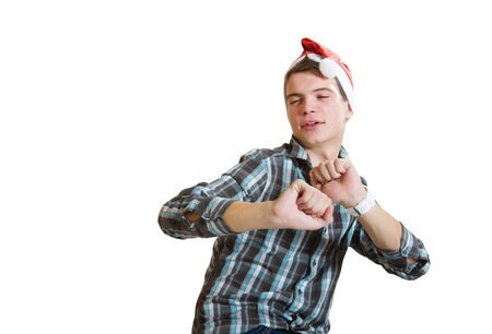 young casual dancing  man in a santa hat isolated on white photo