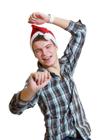 young casual dancing man in a santa hat photo