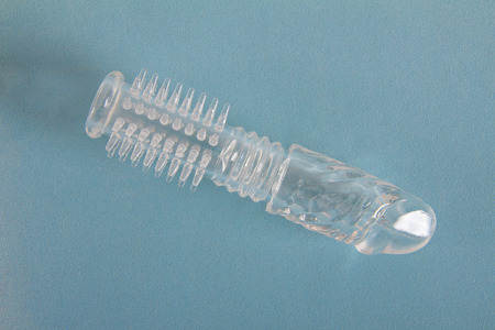 sex toy: Sex toy transparent extender for penis on blue  Stock Photo