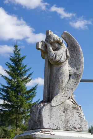Monument of ancient angel on cemetery in Grodno, Belarus Stock Photo - 26601240
