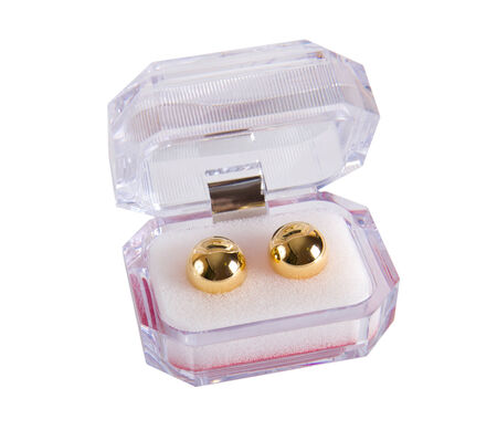 adult sex: Two golden love balls in plastic box - adult sex toy Stock Photo