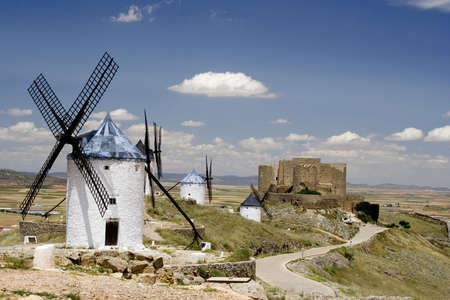 Medieval windmills dating from the 16th century on a hill overlooking the town of Consuegra in Toledo province, Castilla La Mancha, central Spain.  Made famous in Miguel de Cervantes Saavedras novel Don Quijote de la Mancha, these windmills are situated