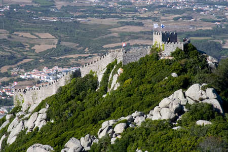 recognised: The Castelo dos Mouros (Castle of the Moors) is located in Sintra, Portugal.  Situated on a high hill overlooking the village, it is part of the Cultural Landscape of Sintra, recognised as an UNESCO World Heritage Site. Stock Photo