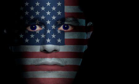 nationalistic: US flag paintedprojected onto a mans face.