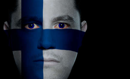 aggressor: Finnish flag paintedprojected onto a mans face.