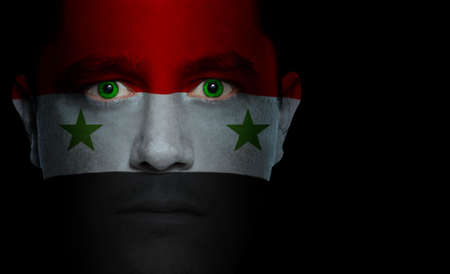 syria: Syrian flag paintedprojected onto a mans face