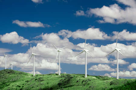Wind turbines standing in the mountains of central Spain. Stock Photo