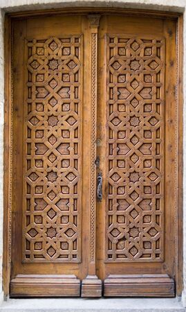 Medieval intricately carved door on a building in Toledo, Spain Stock Photo - 716015