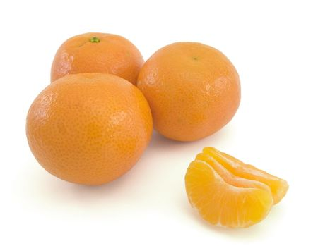 Three tangerines with peeled slices, isolated on a white background.