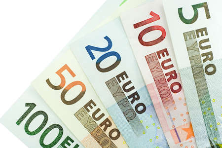 Close-up of 5, 10, 20, 50, and 100 Euro banknotes isolated on a white background