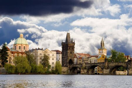 View of the Charles Bridge in Prague from the riverside.