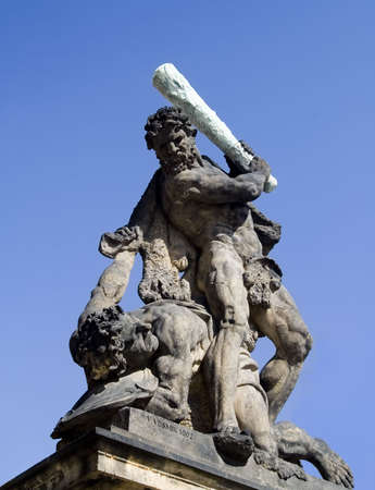 Statue of giant with a dagger from the 18th Century at the Matias Gate entrance to Prague Castle in the Czech Republic. Banco de Imagens