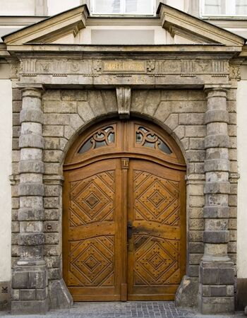 Intricate medieval door in Prague, Czech Republic.