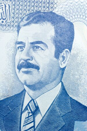 Close-up of one hundred Iraqi dinars banknote.  Features Saddam Hussein. photo