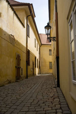 Narrow alleyway with streetlamp in Prague, Czech Republic.