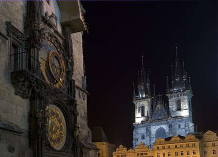 View of the astrological clock and the Church of Our Lady in front of Tyn in Prague from the Old Town Square.  Present gothic church dates from the 14th century.