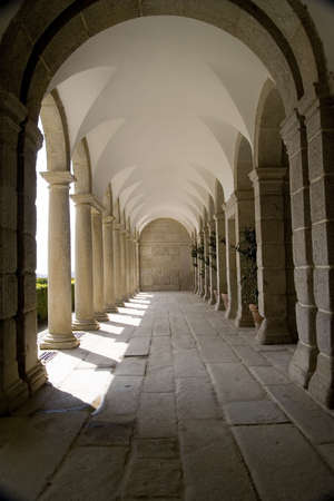 The monastery at San Lorenzo de El Escorial was built in the second half of the 16th century to commemorate the victory at the Battle of St. Quentin in 1557.  It is the burial site for most Spanish kings and is an UNESO World Heritage Site. Stock Photo