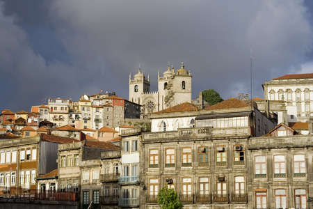 View of the Cathedral in Porto, Portugal with storm clouds in the background.