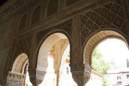 Moorish arches in the Generalife complex in La Alhambra, Granada.