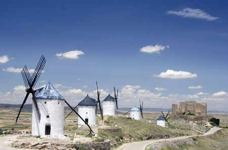 Medieval windmills dating from the 16th century on a hill overlooking the town of Consuegra in Toledo province, Castilla La Mancha, central Spain.  Made famous in Miguel de Cervantes Saavedras novel Don Quijote de la Mancha, these windmills are situated  photo