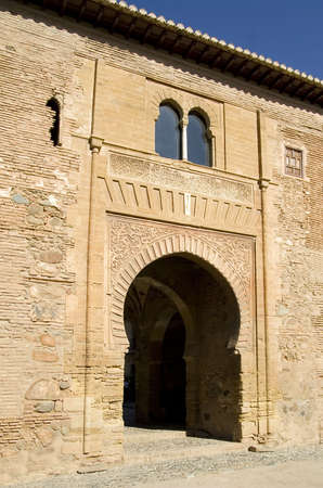 Puerta del Vino (wine gate) provides access to the Alcazaba fortification within the Alhambra in Granada, Spain. photo