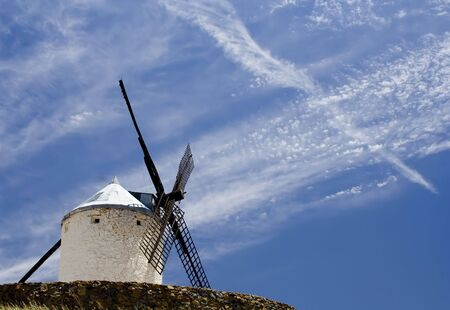 toledo town: Medieval windmill dating from the 16th century on a hill overlooking the town of Consuegra in Toledo province, Castilla La Mancha, central Spain.  Made famous in Miguel de Cervantes Saavedras novel Don Quijote de la Mancha, these windmills are situated a