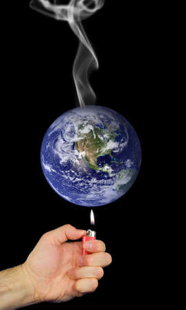 Photo montage representing global warming with lighter held to earth and smoke rising.  Earth photo courtesy of NASA visibleearth.nasa.gov