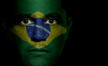 브라질 국기 남자의 얼굴에 페인트  투영입니다. 스톡 콘텐츠