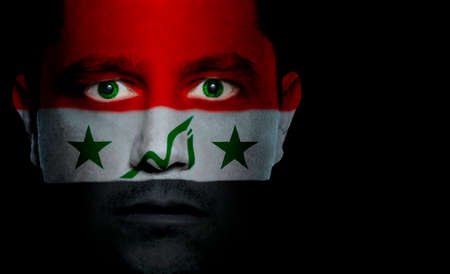 Iraqi flag painted/projected onto a man's face.