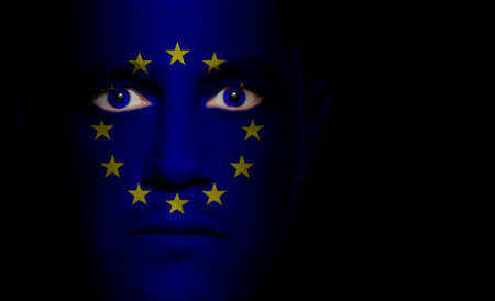 Flag of the European Union paintedprojected onto a mans face. Stok Fotoğraf