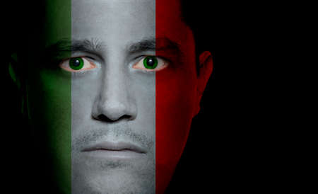 aggressor: Italian flag paintedprojected onto a mans face.