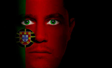 portugal flag: Portuguese flag paintedprojected onto a mans face.