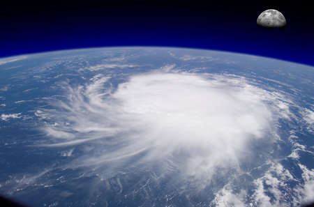 View from space of a giant hurricane over the ocean with moon in background.  Photo montage with photos courtesy of visibleearth.nasa.gov