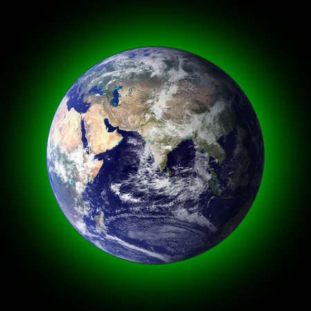 View of the earth from space with a green halo around it.