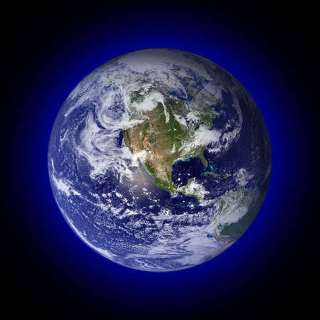 View of the earth from space with a blue halo around it.   Stock Photo
