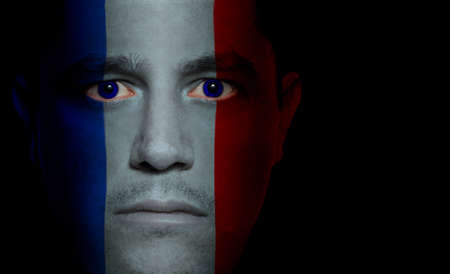 aggressor: French flag paintedprojected onto a mans face.