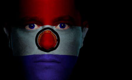 paraguayan: Paraguayan flag paintedprojected onto a mans face. Stock Photo