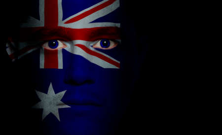 Australian flag paintedprojected onto a mans face. Stok Fotoğraf