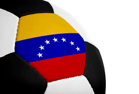 Venezuelan flag paintedprojected onto a football (soccer ball).  Isolated on a white background. photo
