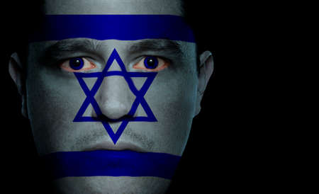 Israeli flag paintedprojected onto a mans face. photo