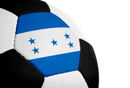 Honduran flag paintedprojected onto a football (soccer ball).  Isolated on a white background. photo