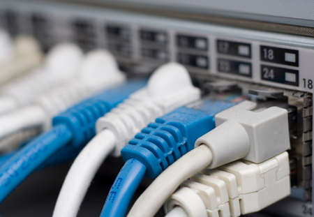 Closeup of a network router with cables attached.  Shallow depth of field. photo